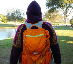 maroon hooded sweater with orange knapsack
